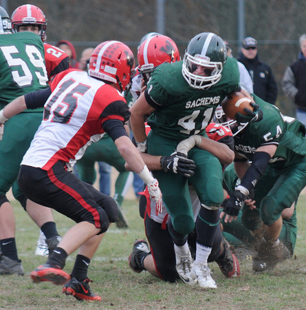 West Newbury: Pentucket's Andrew Noyes fights for yards against Watertown during their game at Pentucket Saturday. Jim Vaiknoras/staff photo