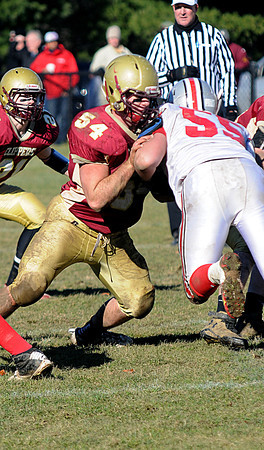 Newburyport: Newburyport's  Andrew Beaupre throws a blockagainst Amesbury during the Clippers 21-7 victory over the Indians at World War Memorial Stadium in Newburyport Thursday. Jim Vaiknoras/staff photo