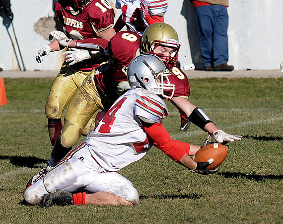 Newburyport: Newburyport's Tyler Therrien knocks pass down intended for Amesbury's Rey Melis during the Clippers 21-7 victory over the Indians at World War Memorial Stadium in Newburyport Thursday. Jim Vaiknoras/staff photo
