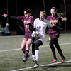 Lynn: Newburyport's Julia Kipp fights for the ball with Siobhan O'Connell during their game at Manning Field in Lynn. Jim Vaiknoras/staff photo
