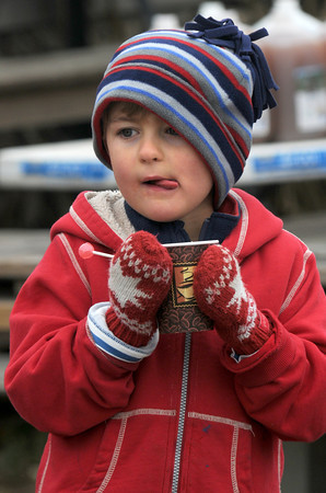 Amesbury: Ben Hawes, 5, enjoys a cup of cider at the Cider Hill 5k Sunday morning at Cider Hill Farm in Amesbury. Jim Vaiknoras/staff photo