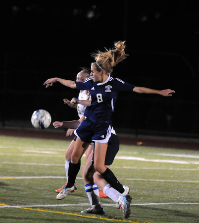Woburn:  Triton'sMorgan Snow collides with Lynnfield's Sydney Johnian during their game at Woburn High. Jim Vaiknoras/staff photo