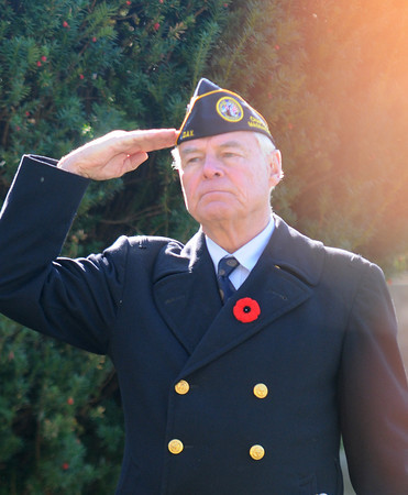 newburyport: Veteran's Agent Kevin Hunt salutes during the playing of taps at Veteran's Cemetary in Newburyport. Jim Vaiknoras/staff photo