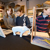 Newburyport: Hanna Gustafson, 9, Silas Cash, 8, and Will Conrad, 8, look over projects done by their classmates at the River Valley Charter School on display at the Bewburyport Maritime Museum Saturday. After being invited to the museum the students decided to create projects inspire by some of the exibites they saw, projects on mastadon, shipwrecks, and the Coast Guard for example. A gala was held Friday night for students, parents and Teachers. Jim Vaiknoras/staff photo s