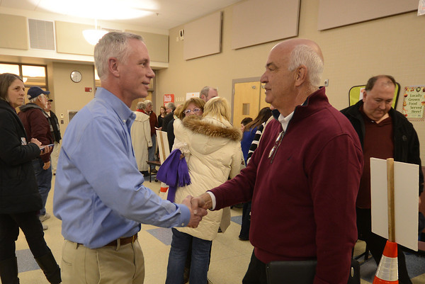 Amesbury: Mayoral Thacher Kezer shakes hands with challenger Ken Grey at Amesbury High school after Greys 8 vote victory in the mayoral candidate. Jim Vaiknoras/staff photo