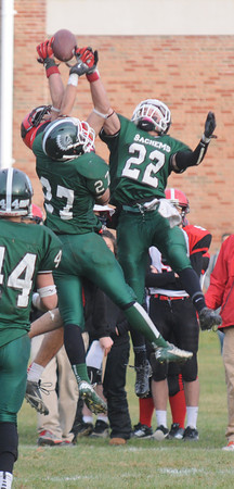 West Newbury: Pentucket's Jeff Porter and Darren Engelke brake up a pass intended for Watertown's T.J. Hairston during their game at pentucket Saturday. Jim Vaiknoras/staff photo