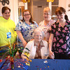 Newburyport:Brigham Manor Program Director Denise Blinn, aids Sandra Demand, Loretta Souther, and Leona Chase, pose with Charlotte Hughes<br /> at her 100th birthday celebration Friday. Jim Vaiknoras/staff photo