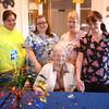 Newburyport:Brigham Manor Program Director Denise Blinn, aids Sandra Demand, Loretta Souther, and Leona Chase, pose with Charlotte Hughes<br /> at her 100th birthday celebration Friday. Jim Vaiknoras/staff photo