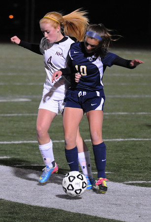 Lynn: Newburyport's Abbie Bresnahan fights for the ball wth a Lynnfield player during their game at Manning Field in Lynn. Jim Vaiknoras/staff photo