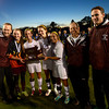 Worcester:Newburyport soccer captains, from left,Lilly Donovan Aly Leahy, Carly Brand and Jaycie Triandafilou and their coaches with the championship trophy in the North Div 3 finals at Foley Stadium in Worcester,The Clipper's won the game 1-0, giving them the Division 3 State Championship. Jim Vaiknoras/staff photo