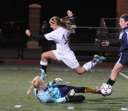 Lynn: Newburyport's Jaycie Triandafilou jumps over Lynnfield goalie Hannah Travers during the  Clippers victory over Lynnfield in the North Div 3 finals  at Manning Field in Lynn. Jim Vaiknoras/staff photo