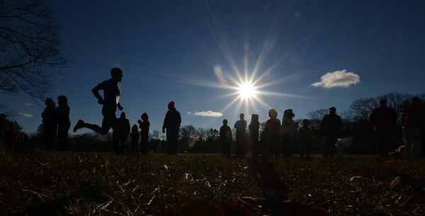 Newburyport: Runners head to the finish line on a bright cold Thanksgiving morning at the 25th annual Maudslay Turkey Trot in Newburyport Thursday morning. Jim Vaiknoras/staff photo