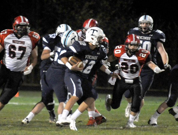 Byfield: Triton's Bradley Whitman scrambles up field during the Viking's home game against Watertown. Jim Vaiknoras/staff photo