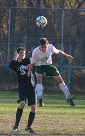 West Newbury: Pentucket's David Greene goes up for a header with Triton's  Jason Tidmarsh during their game at Pentucket Friday. The Sachems won the game 3-0. Jim Vaiknoras/staff photo
