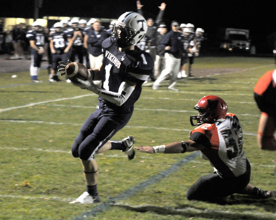 Byfield: Triton's Justin Cashman scores in the first quarter  during the Viking's home game against Watertown. Jim Vaiknoras/staff photo