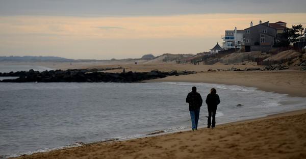 Newbury: A couple walk down a lonely stretch of Plum Isalnd beach Sunday afternoon. Jim Vaiknoras/staff photo