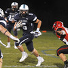 Byfield: Triton's Justin Spillane looks for running room during the Viking's home game against Watertown. Jim Vaiknoras/staff photo