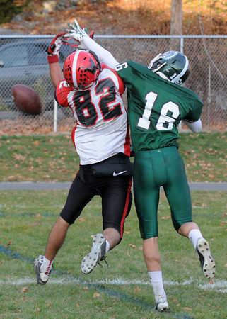 West Newbury: Pentucket's Liam Corkery brakes up a pass intended for Watertown's T.J. Hairston in the endzone during their game at Pentucket Saturday. Jim Vaiknoras/staff photo