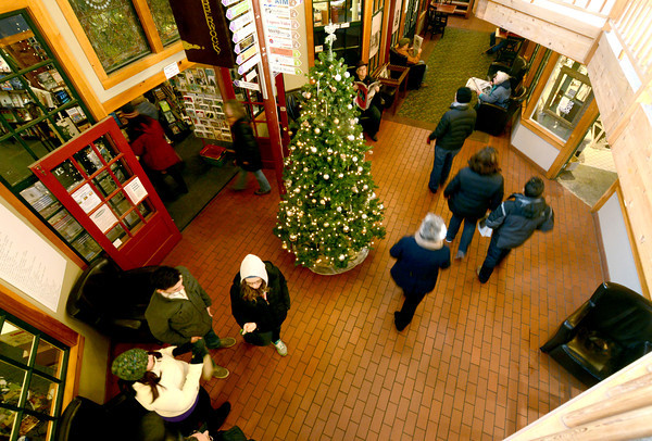 Newburyport: Shoppers stream by the Christmas Tree in the Tannery Friday afternoon. Jim Vaiknoras/staff photo