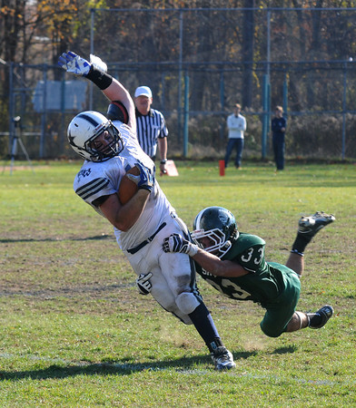 West Newbury: Pentucket's Josh Wesolowski tackles Hamilton-Wenham'sPeter Duval during teir game at Pentucket Saturday. Jim Vaiknoras/staff photo