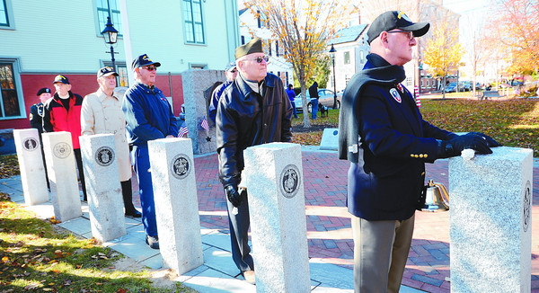 Newburyport : Veterans stand at new markers commemorating branches of the Us Armed Services. from The right, Dick George Army 101st Airborn, Marine Commander Alex Kravchuk, Navy, Dick Potter USS Rudfird, Air Force bomber navagator Arnold Lasard, Coast Guard Ralph Ayes, and national Guard Master Sargent Roland Cormier. Each would ring a bell as the roll call was read. Jim Vaiknoras/Staff photo