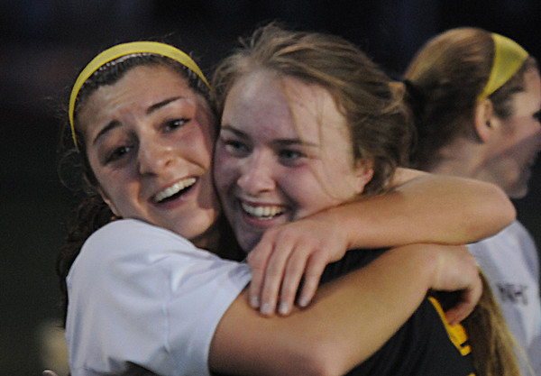 Worcester: Newburyport's Maryam Moshrefi hugs teammate Lilly Donovan after the Clipper's 1-0 victory over Granby at Foley Stadium in Worcester, giving them the Division 3 State Championship. Jim Vaiknoras/staff photo