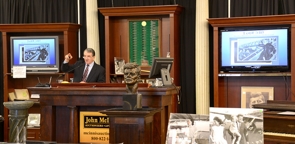 amesbury: Auctioneer Richard Oliver takes bids at McInnis in Amesbury Saturday afternoon. Jim Vaiknoras/staff photo