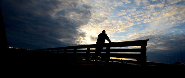 Salisbury: Marty Reed of Lowell looks out on a setting sun from Salisbury Town dock late Monday afternoon.Jim Vaiknoras/staff photo