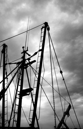 Newburyport: The mast and rigging on the Early Time stand against a cloudy November sky in the embayment along the waterfront in Newburyport Sunday. Jim Vaiknoras/staff photo