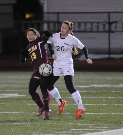Lynn: Newburyport's Delaney Bartol fights for the ball with Bishop Spellman's Andriana Forcucci during their game at Manning Field in Lynn. Jim Vaiknoras/staff photo