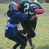 West Newbury: Triton's Sarah Colins grabs the flag of Pentucket's Carley Desjardins  during the Powder Puff game at Pentucket High Saturday. Jim Vaiknoras/staff photo