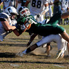 West Newbury: Pentucket's Andrew Noyes fights for extra yardage against Hamilton -Wehman  during their game at Pentucket Saturday. Jim Vaiknoras/staff photo
