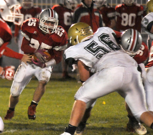 Amesbury: Amesbury's Ben Cullen looks for running room against North Reading. Jim Vaiknoras/staff photo