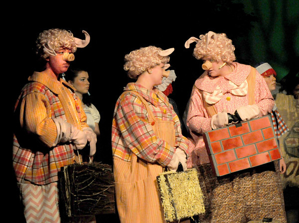 West Newbury: Nate Joyall, Danny DiCamillo, and Whitney Lischke as the Three Little Pigs  in the Pentucket high school production of Shrek the Musical. Jim VAiknoras/staff photo