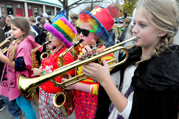 Newbury: The Newbury Elementary School band donned costumes as well as the rest of the school body as they provided music as the annual Halloween Parade went around the parent-lined school driveway. Bryan Eaton/Staff Photo