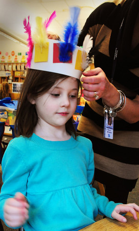 Salisbury: Quinn McManus, 5, gets help with the head dress she just made from her kindergarten teacher Jane Keeler at Salisbury Elementary School on Tuesday afternoon. The students had learned about Pilgrims last week and this week about Native American Indians and the foods they ate. Bryan Eaton/Staff Photo