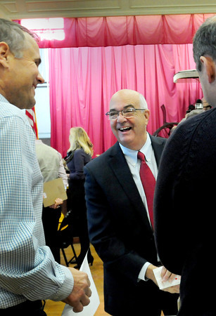 Amesbury: Ken Gray flashed a smile during yesterday's mayoral recount in Amesbury Town Hall, and he would smile later as the results showed that he is now officially mayor-elect, keeping his two point lead over incumbent Mayor Thatcher Kezer. Bryan Eaton/Staff Photo