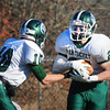 Byfield: Pentucket quarterback Ryan Kuchar hands off to Darren Engelke. Bryan Eaton/Staff Photo