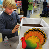 Newbury: David Pugh, 8, decorates one of the boxes to be used for distribution of Thanksgiving food to area families and organizations. The Newbury Elementary School Student Council organized the Together to Gather asking fellow students for a $2 donation for turkeys and non-perishable foods as well. Bryan Eaton/Staff Photo
