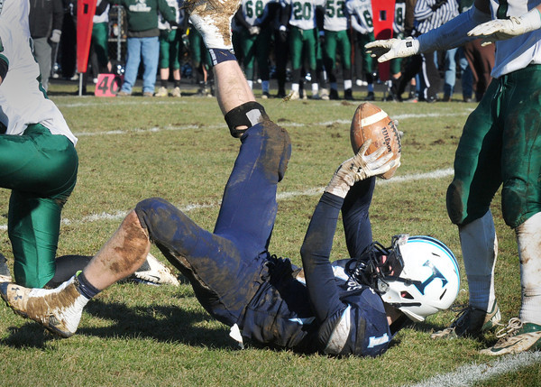 Byfield: Triton's Justin Cashman shows the referees he has the ball on a pass reception. Bryan Eaton/Staff Photo