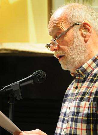 "Newburyport: Tom Miller of Ipswich reads his work ""The Dancer."" Bryan Eaton/Staff Photo"