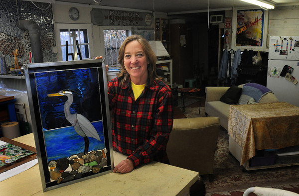 Amesbury: Leslie Doherty in her Potlatch Studio and Gallery in Amesbury. Bryan Eaton/Staff Photo