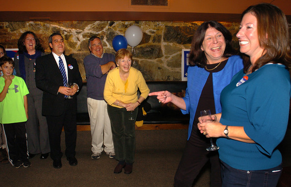 Newburyport: Newburyport Mayor Donna Holaday celebrates her re-election with supporters and her campaign manager Colleen Guillou, right, downstairs at David's Restaurant. Bryan Eaton/Staff Photo