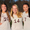 Newburyport High soccer players Delaney Bartol, Amy Sullivan and Erin Filetti. Bryan Eaton/Staff Photo