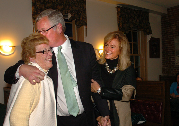 Newburyport: Newburyport mayoral candidate Richard Sullivan Jr. gives his mom Laurine a kiss, with girlfriend Penny Stauffer by his side, before he addresses his supporters at the Starboard Galley. Bryan Eaton/Staff Photo