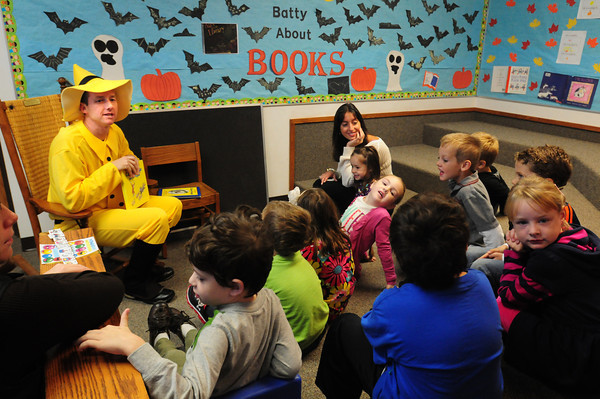 """Newburyport: Sean Reardon dresses as the Man With the Yellow Hat from Curious George as he reads to his daughter Sadie's class at the Brown School recently for their """"Batty About Books."""" Bryan Eaton/Staff Photo"""