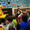 "Newburyport: Sean Reardon dresses as the Man With the Yellow Hat from Curious George as he reads to his daughter Sadie's class at the Brown School recently for their ""Batty About Books."" Bryan Eaton/Staff Photo"
