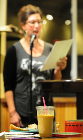 Newburyport: Susan LaFortune of Haverhill reads above iced coffee at Plum Island Coffee Roasters. Bryan Eaton/Staff Photo