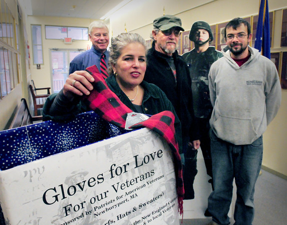 Newburyport: Don Jarvis and Frank Peluso have started started Patriots for American Veterans, a local nonprofi to support veterans. They're  having a glove drive and collecting donations, including scarves, here at Newburyport City Hall,  for the New England Center for Homeless Veterans in Boston.  From left, Vetaran's agent Kevin Hunt, Tammy Jenning, secretary, Frank Peluso and Don Jarvis. Bryan Eaton/Staff Photo