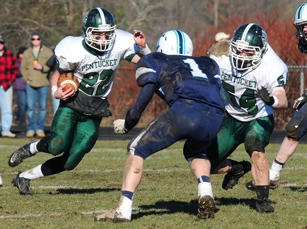 Byfield: Pentucket's Jeff Porter makes the carry as Triton's Justin Cashman was there to assist in the tackle. Bryan Eaton/Staff Photo